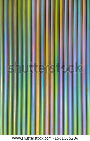 An abstract lines backround of colorful cadmium coated steel bars. Vertical orientation and direction. #1581185206