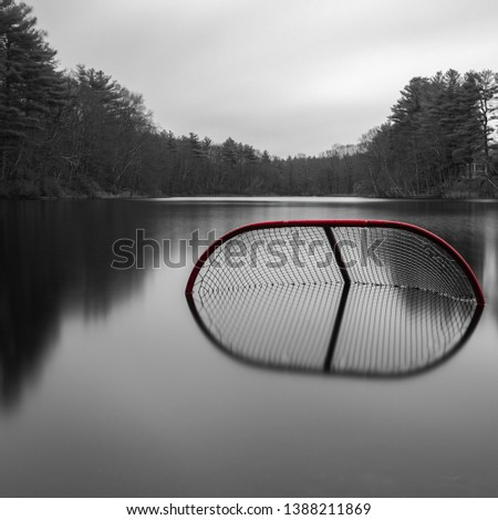 an abstract long exposure shot of a forgotten hockey net,