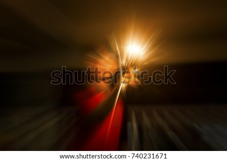 Stock Photo An abstract of human shape touching a glowing light.