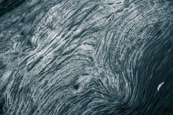 An abstract pattern of a foam forming in the river. Beautiful abstract monochrome background pattern.