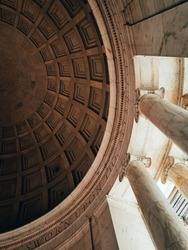 An abstract photo of the pillars and interior of the Jefferson Memorial.