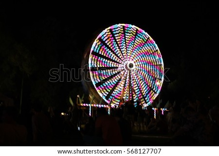 An abstract picture of a carousel rotating in the night
