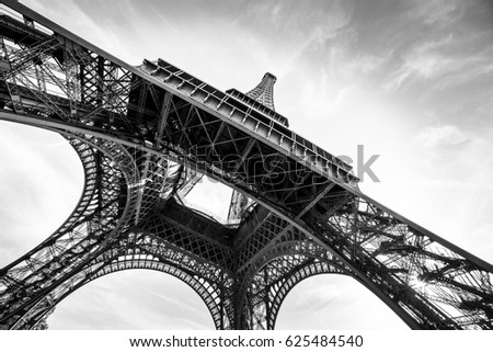 An abstract retro view of an Eiffel Tower against Sun in black and white colors, Paris, France