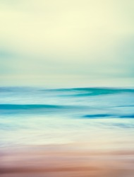 An abstract seascape with blurred panning motion and long exposure.  Image displays a retro, vintage look with cross-processed colors.