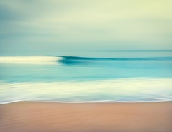 An abstract seascape with blurred panning motion.  Image displays a retro, vintage look with cross-processed colors.