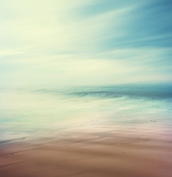 An abstract, time-exposure seascape with panning movement.  Image displays a retro, vintage look with cross-processed colors.
