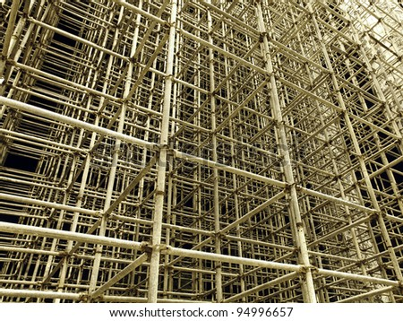 An abstract view of the chaotic pattern of metal scaffolding.