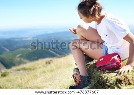 An accident on a mountain trail. First aid kit in a backpack tourists.