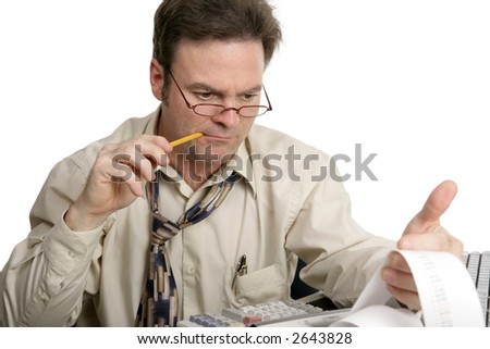 An accountant concentrating on his calculations.  Isolated on white.