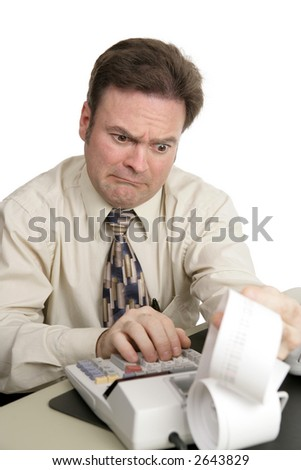 An accountant going over figures and very upset by the result.  Isolated on white.