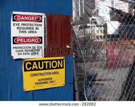 An active construction site with warnings posted outside.