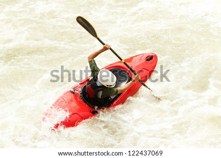 an active kayaker on the rough water