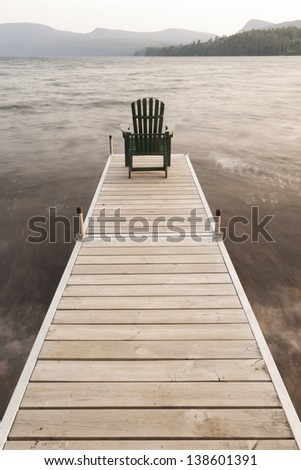 An adirondack chair on a dock at Lake Willoughby, Vermont, USA