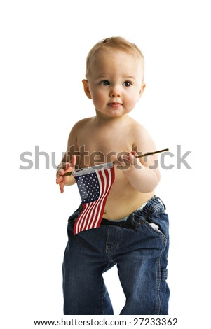 An adorable baby boy holding an American flag.  Isolated on white.