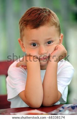 An adorable little boy upset