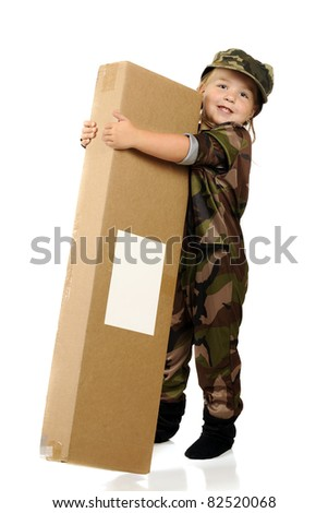 "An adorable little girl ""soldier"" happily receiving a gift from home.  Isolated on white."