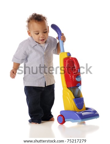 An adorable mixed-race toddler working with his toy vacuum cleaner.  Isolated on white.