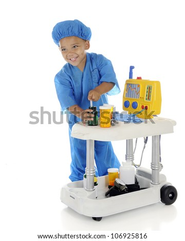 """An adorable preschool """"doctor"""" happily drawing up medicine from his emergency cart.  On a white background."""