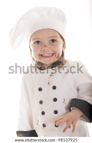 An adorable preschooler in a chef's outfit, happily messy from her chocolate cake batter.  On a white background.