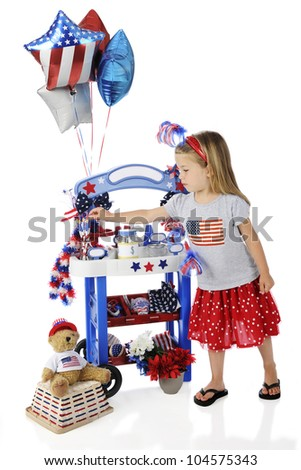 An adorable preschooler selecting a pencil from her Fourth of July vendor stand.  The stand's signs are left blank for your text.  On a white background.