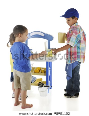 An adorable preschooler selling lemonade to his younger neighbors.  Sign on lemonade stand left blank for your text.  On a white background.