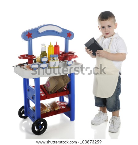 An adorable preschooler standing by his hot dog stand calculating the cost of your order.   The stand's signs left blank for your text.  On a white background.