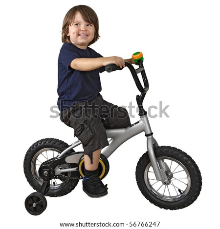 An adorable 3-year-old riding his bicycle fitted with training wheels.
