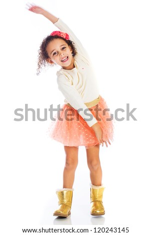 An adorable young African American girl with a bright smile