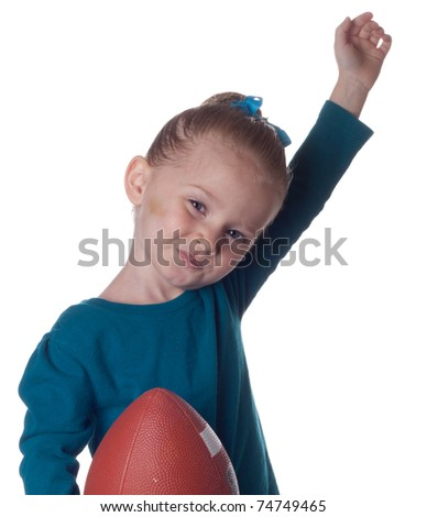 An adorable young child has just scored a touchdown!!!