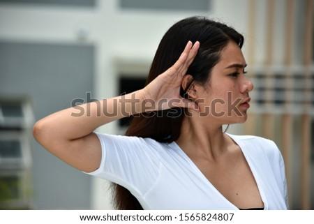 An Adult Asian Female Listening #1565824807