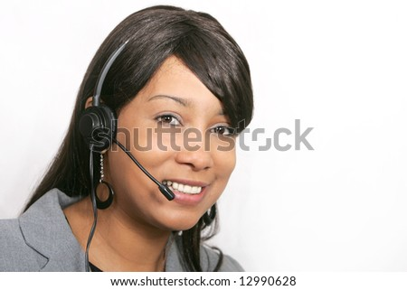 an adult female customer service representative headshot portrait with her headset on ready to work