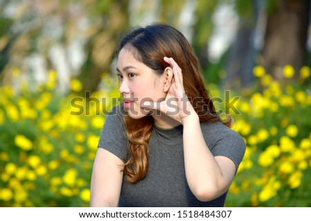 An Adult  Filipina Female Listening