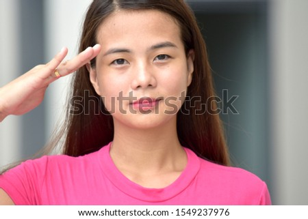 An Adult  Filipina Female Saluting