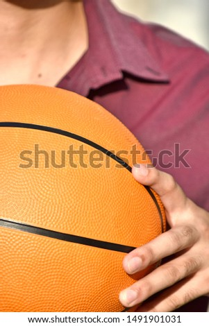 An Adult Male Holding Basketball