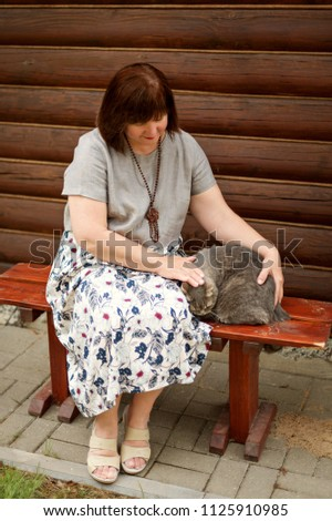 an adult plump woman sits on a...