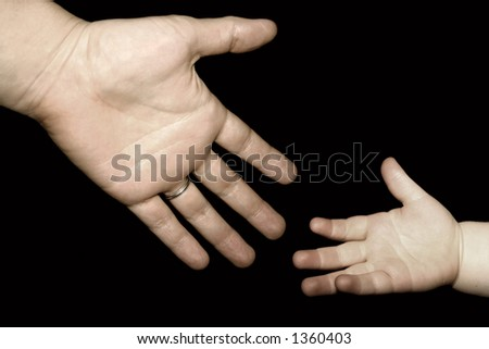 child reaching for hand
