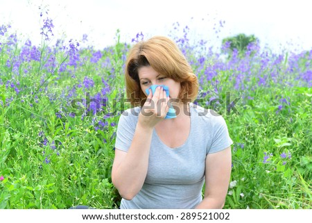 An adult woman with allergies on the Meadow