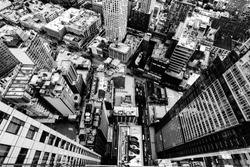 An aerial grey scale shot of the buildings and streets in New York City, United States