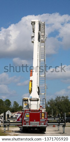 An aerial ladder truck with the ladder fully extended. #1371705920