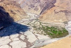 An aerial landscape of the confluence of the Pin and Spiti rivers from the Himalayan village of Dhankar in the Spiti Valley in Himachal Pradesh, India.