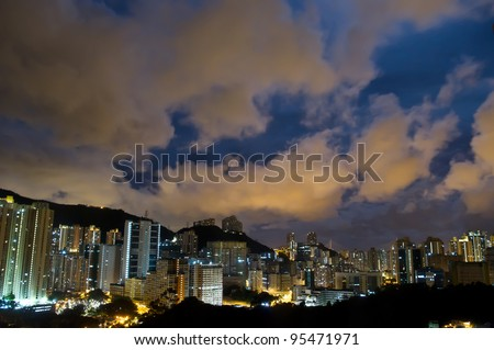 an aerial overlook an hong kong city at night with clouds in the sky