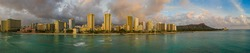 An aerial panorama view of Waikiki Beach and Diamond Head from the ocean in the evening.