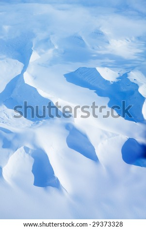 An aerial shot of snow covered mountains in Northern Norway