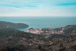 An aerial shot of the coastal area with the beautiful blue seascape and skyscape in