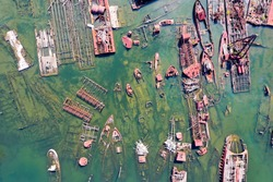 An aerial view from above of abandoned ships at Arthur Kill Boat Graveyard in Staten Island, New York.