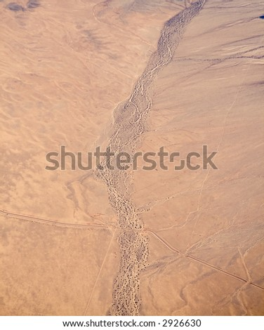 An aerial view of a dried riverbed in the California Mojave Desert