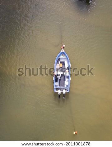 An aerial view of a fishing boat in Mira river in Vila Nova de Milfontes, Alentejo region, Portugal Сток-фото ©
