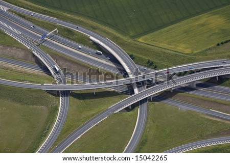 An aerial view of a motorway junction and flyover.