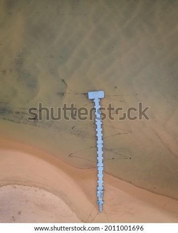 An aerial view of a pedestrian pier along Mira river in Vila Nova de Milfontes in Beja, Alentejo Сток-фото ©