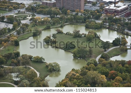 An aerial view of a pond on a cloudy day.